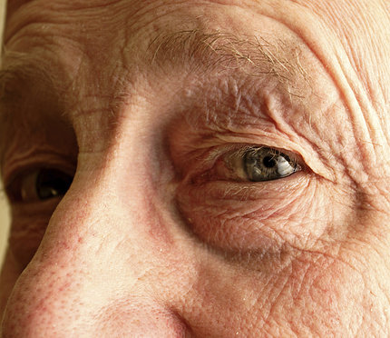 a close up of an older man's eyes