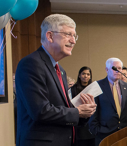 NIH director Dr. Francis Collins addresses the group while Rep. Pete Sessions looks on.
