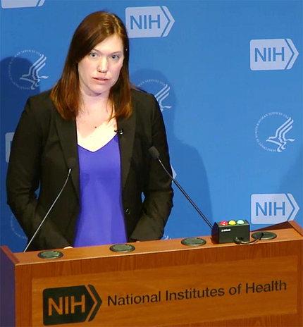 Dr. Benya speaking at the podium.