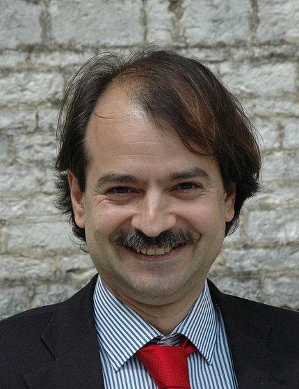 Headshot of Dr. John Ioannidis