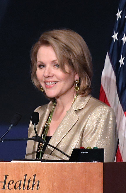 Fleming speaks at podium