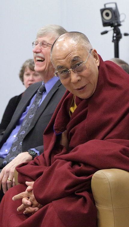 The Dalai Lama smiles, with Dr. Francis Collins laughing in background.