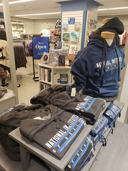 view inside bookstore showing shelves with NIH logo merchandise in foreground
