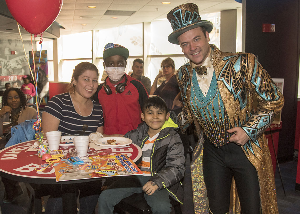 Circus ringmaster meets patient and parent.