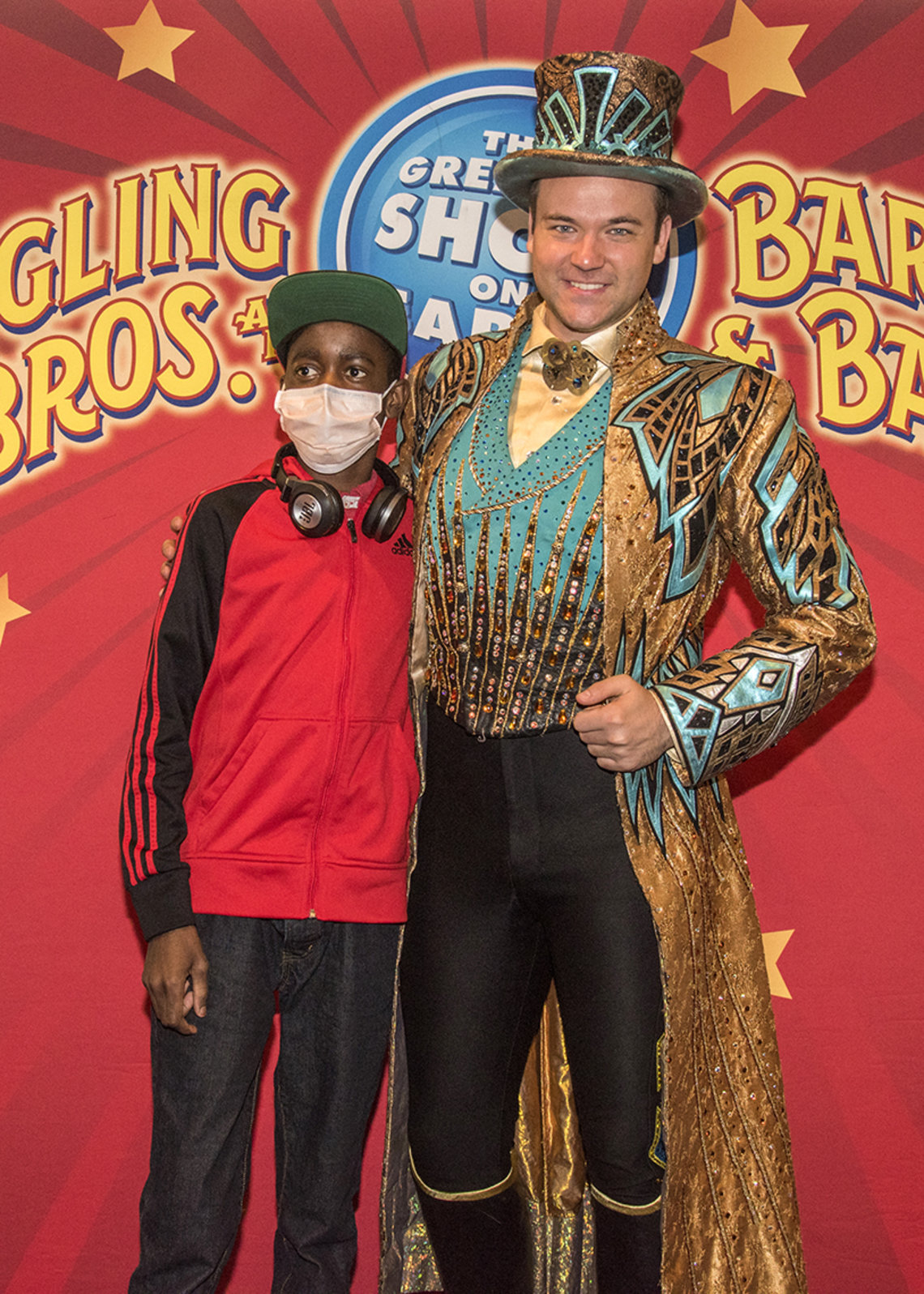Young patient is greeted by ringmaster.