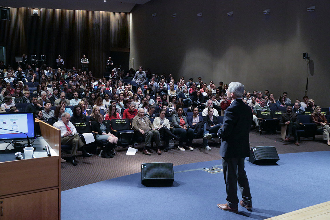 Fauci looks out onto audience