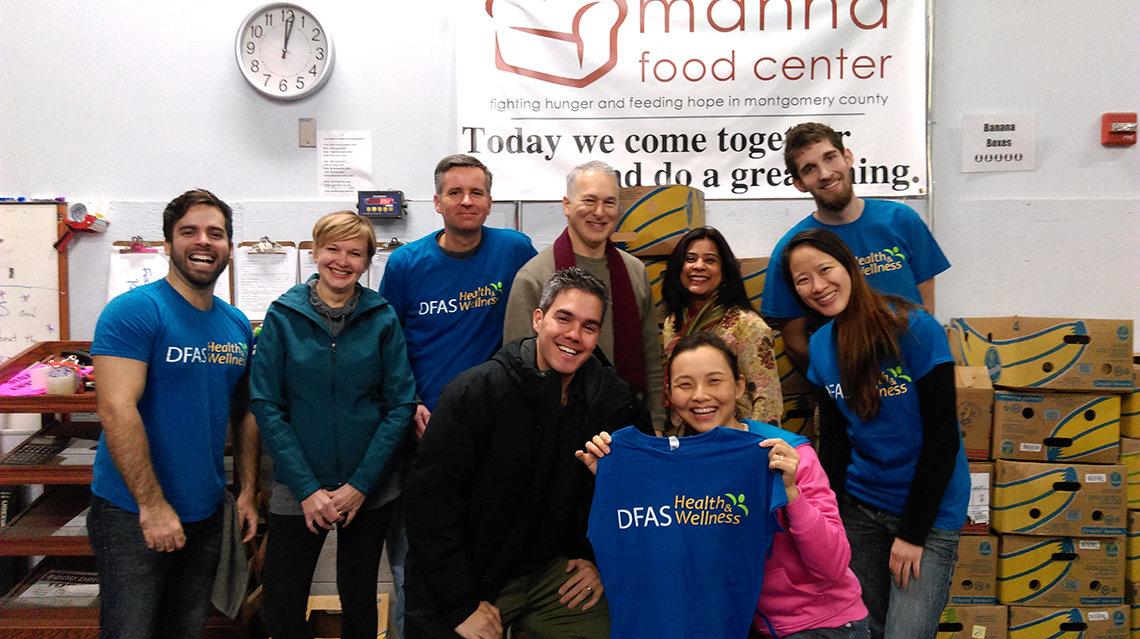 NIH volunteers pose at Manna Food Center.