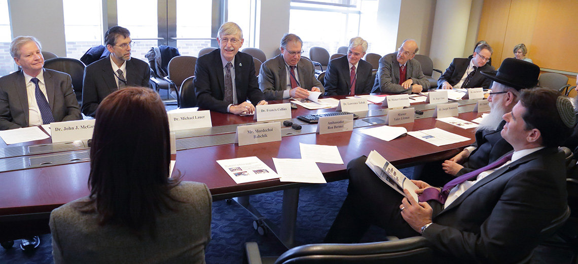 NIH leaders and the Israeli leaders seated around board room table