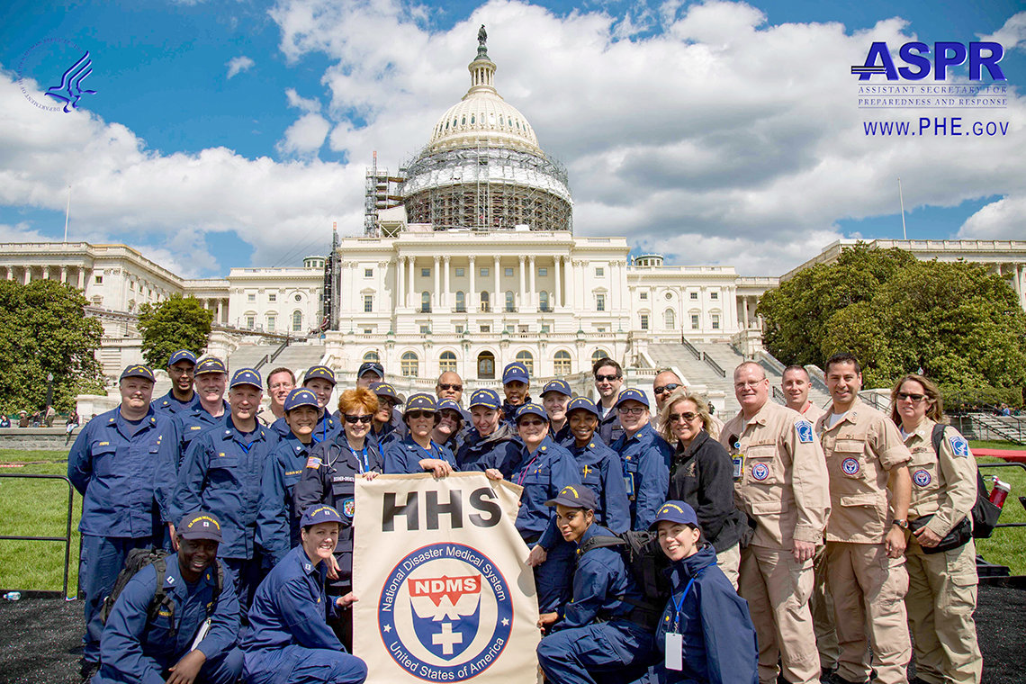 Large group of uniformed people stand in front of the U.S. Capitol