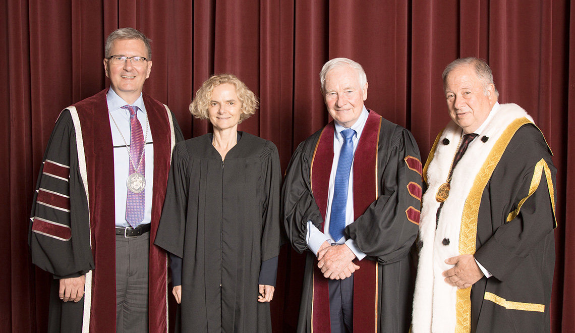 Shepard, Volkow, Johnston and Wener smile wearing graduation ceremony gowns