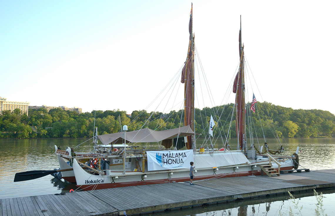 The voyaging canoe tied up at the dock in Georgetown
