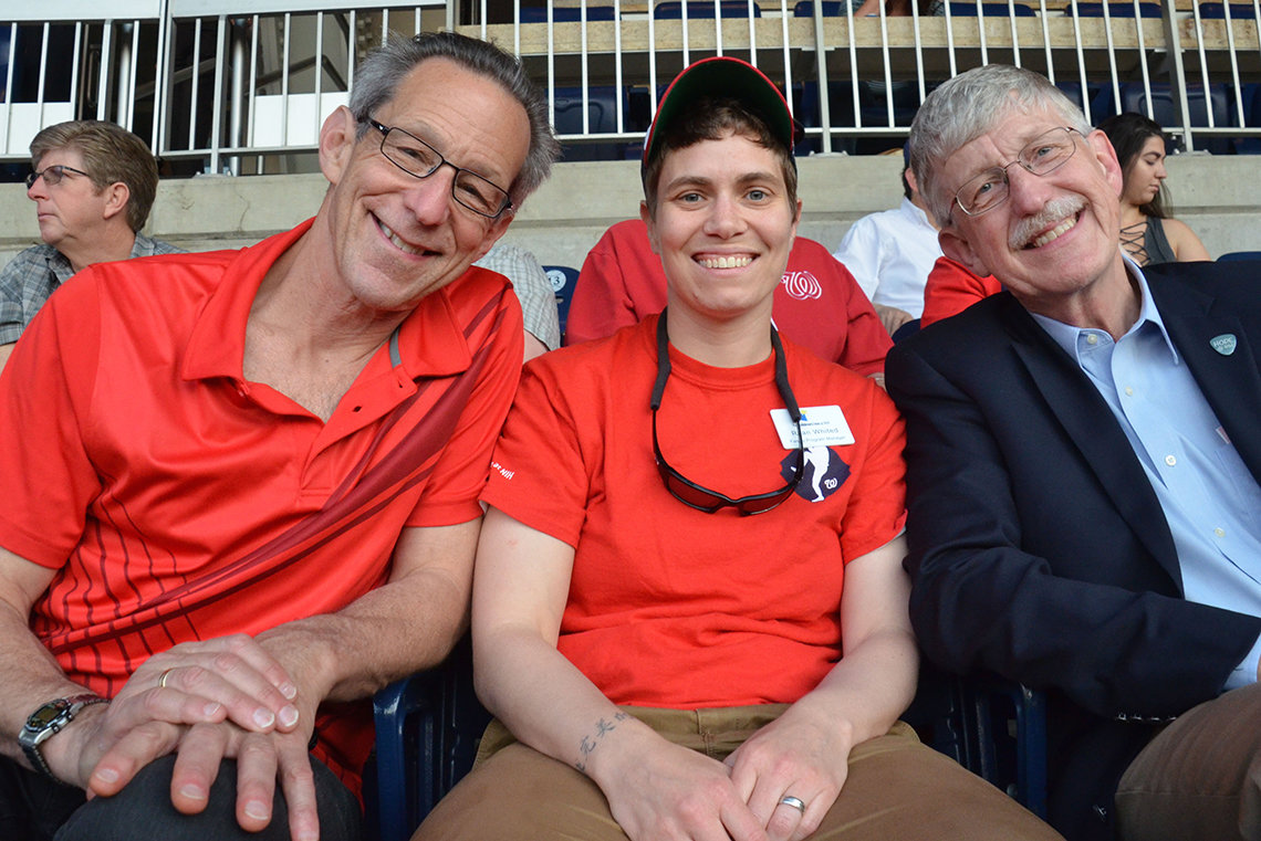 Dr. Collins in the stands with friends.