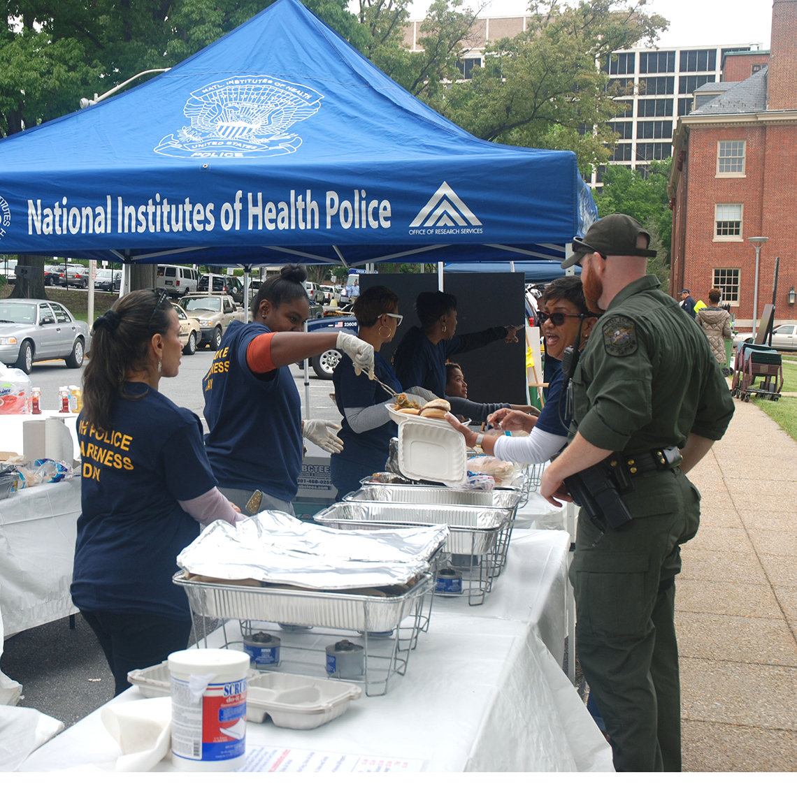 Volunteers serve lunch