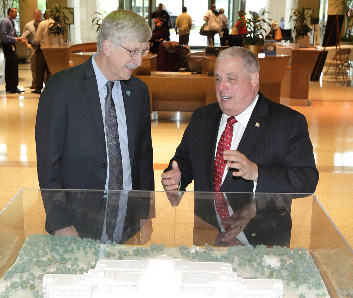 Collins and Hogan stand chatting in CRC atrium.