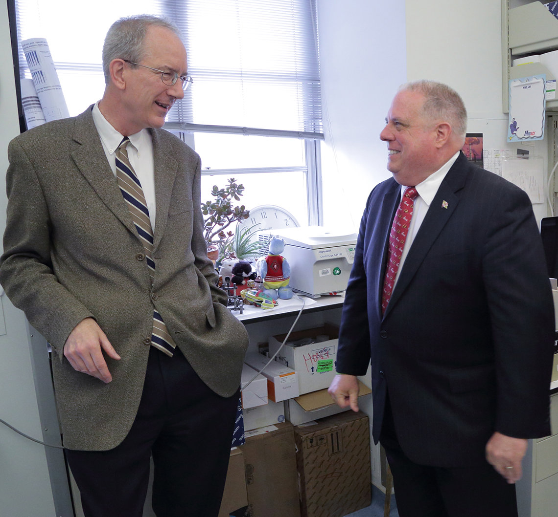 Hogan and Dr. Staudt chat in his lab.