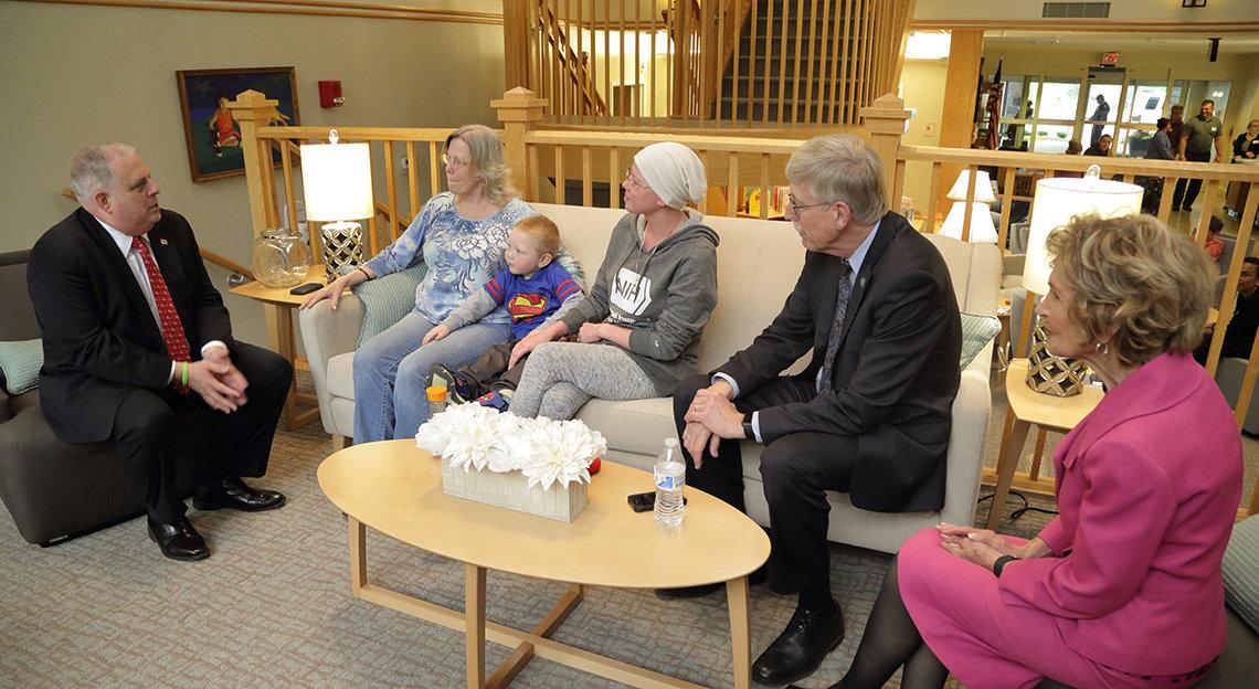 Hogan, Morella and Middleton family sit talking at the Inn.