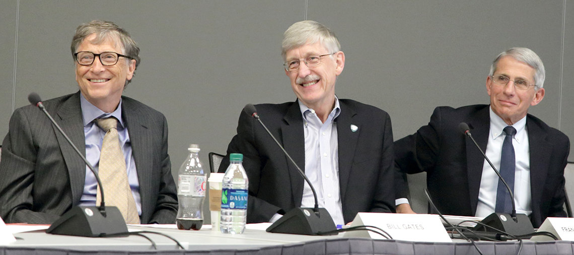 Gates, Collins and Fauci seated at a panel table