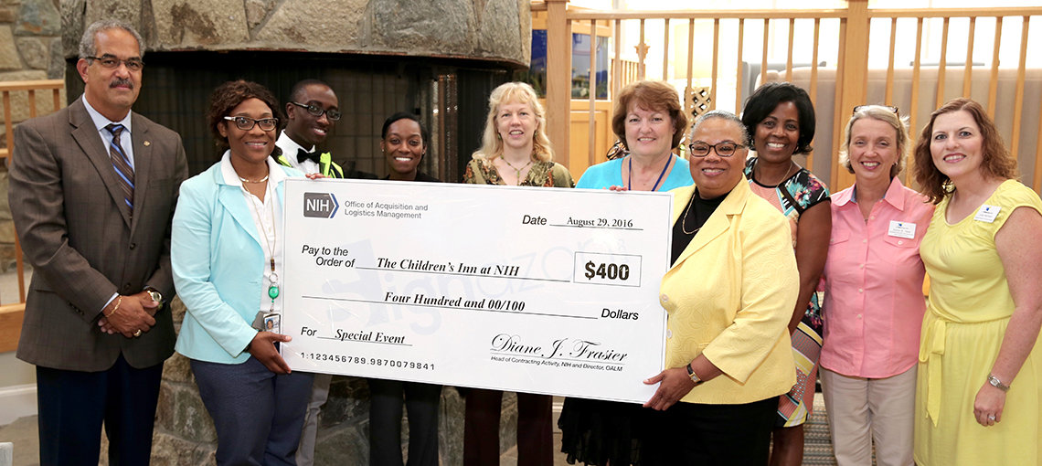 Frasier presents a large check to the inn