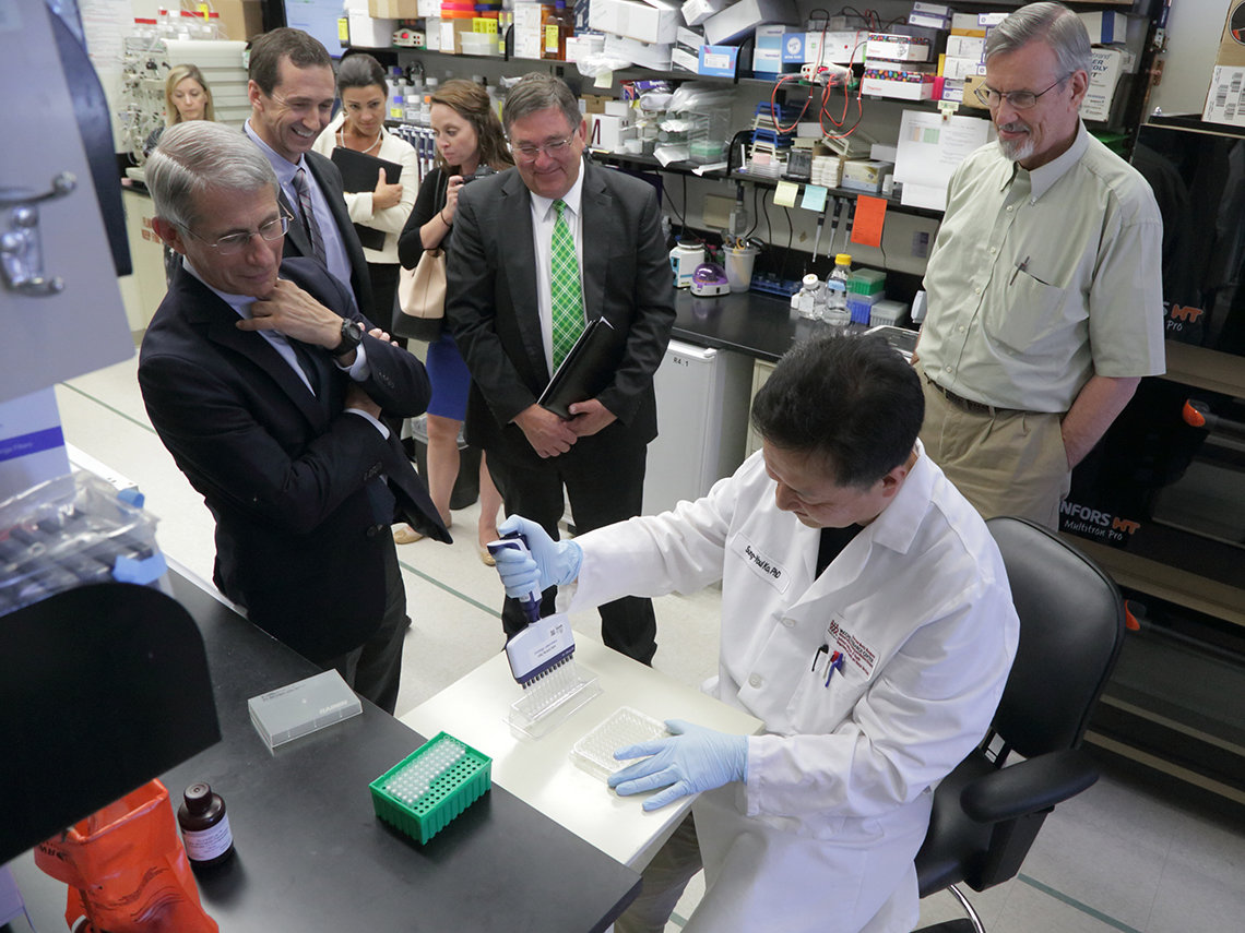 Rep. Burgess with scientists in the lab