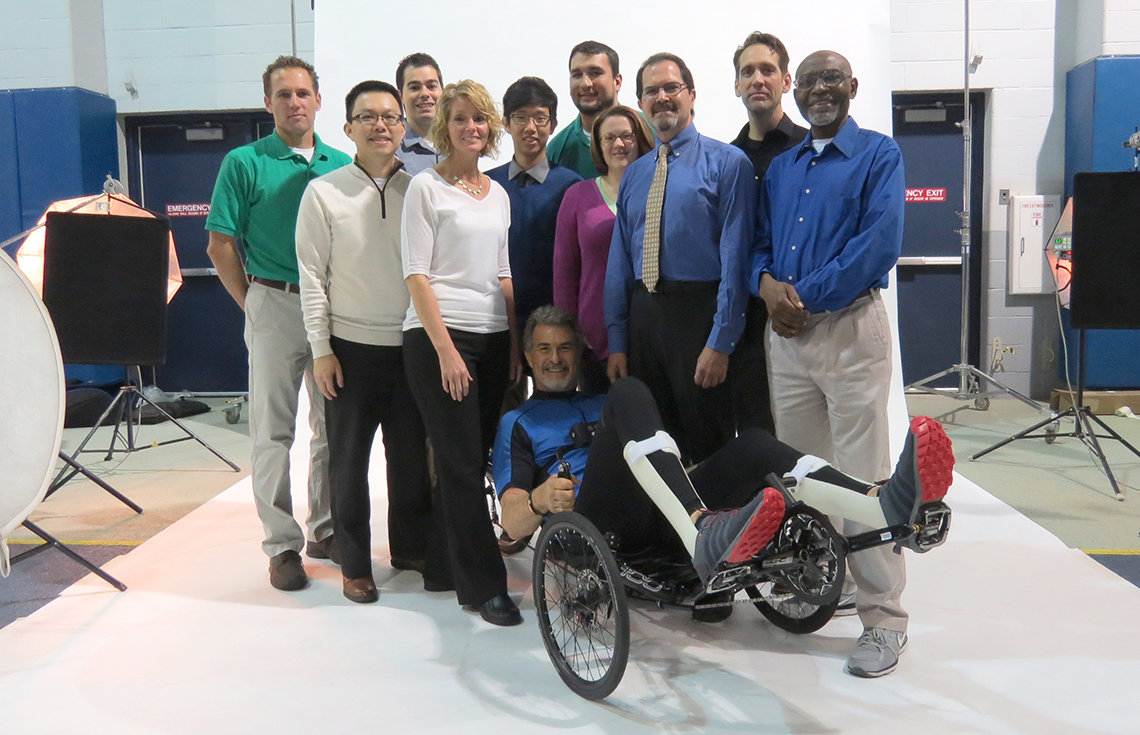 Cybathlon pilot McClellan is surrounded by members of Team Cleveland
