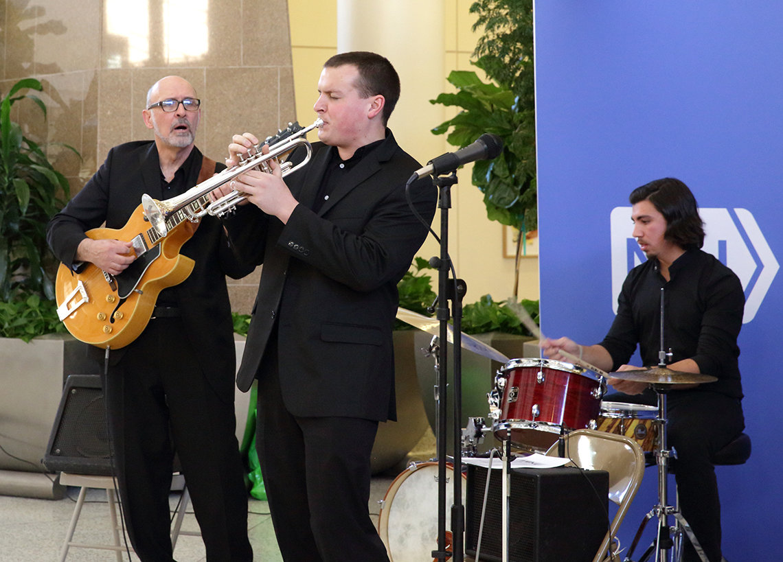 Three University of Maryland Jazz Quintet members-guitar, trumpet and drums