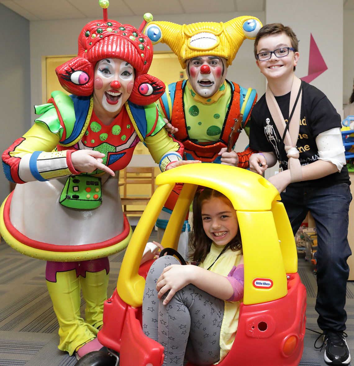 In toy car, driver Ellasyn Berry is joined by circus clowns and Rylan Michael Pederson.