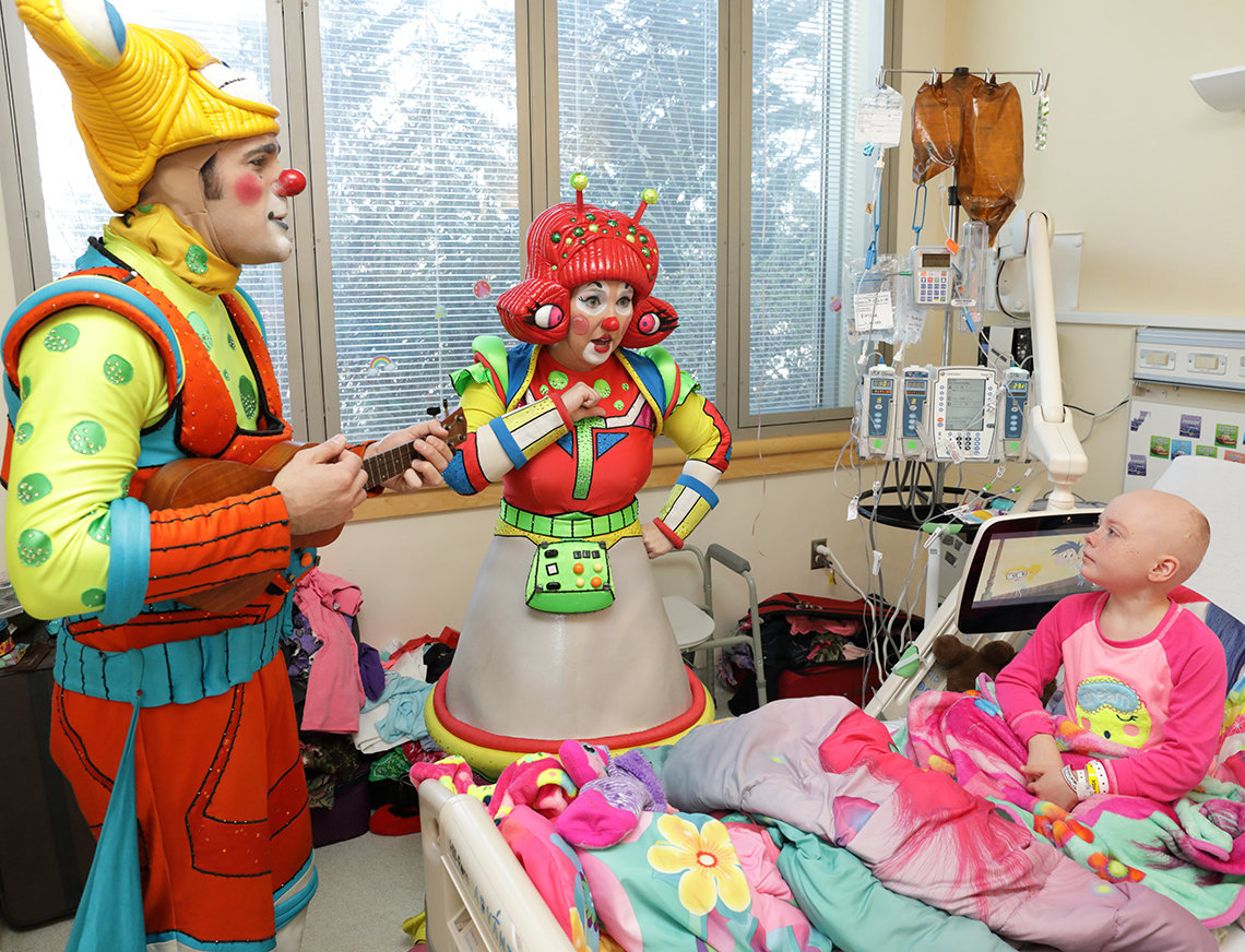 Circus clowns treat Ponzar to an impromptu concert.