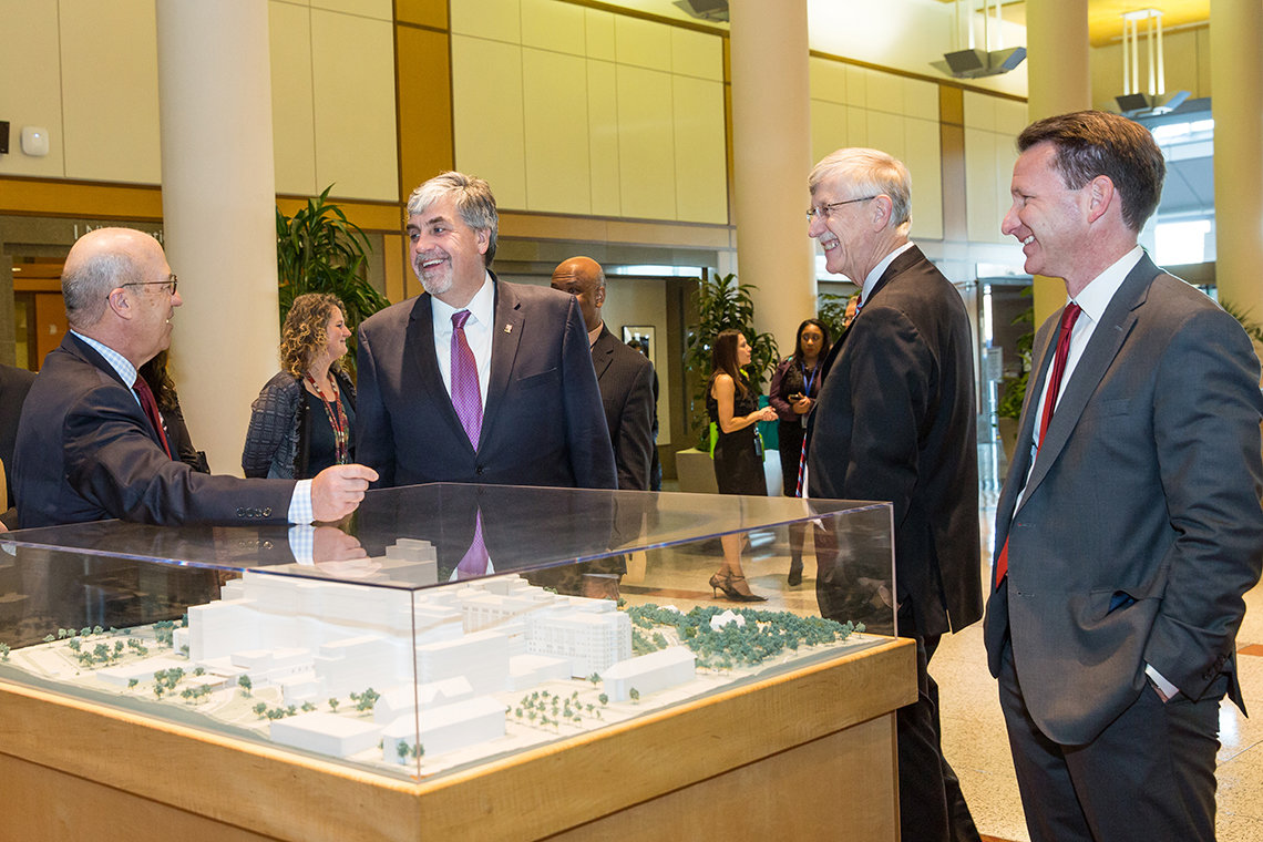 Hargan views model of hospital at NIH.