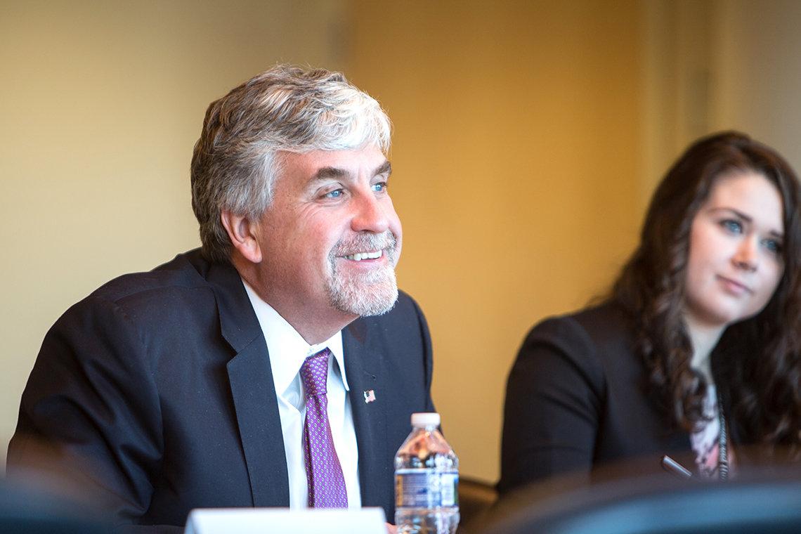 Hargan listens to NIH leaders.