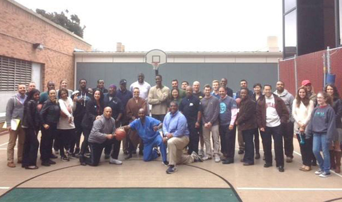 NIH'ers pose on basketball court
