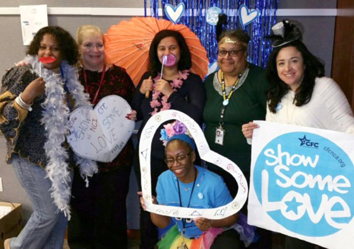 NIH'ers pose together with heart and Show Some Love banner.
