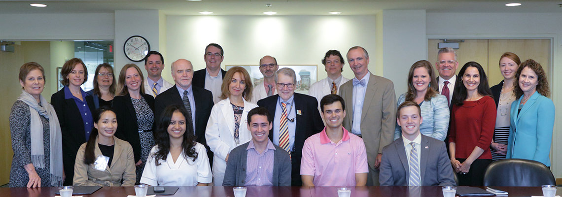 Katz and Carter take a group photo with congressional staff, NIAMS Coalition members and NIAMS staff