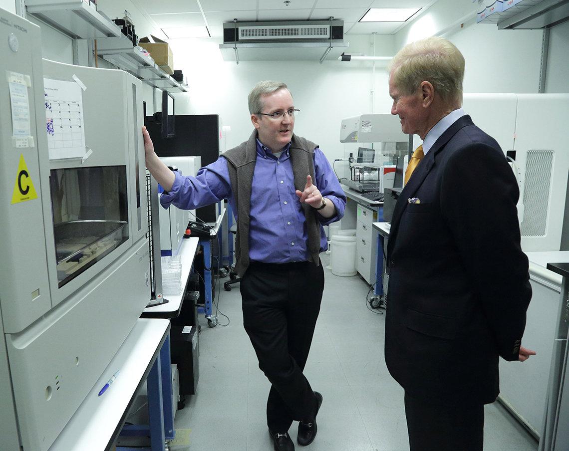 Traynor briefs Nelson in a lab