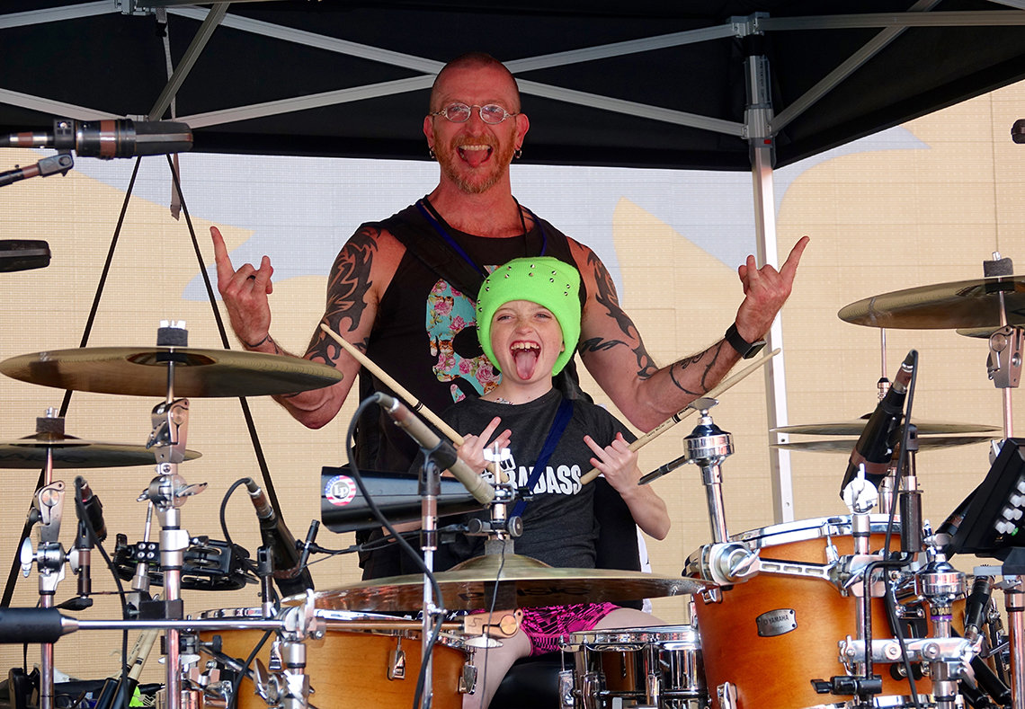 Mackenzie plays the drums with her father