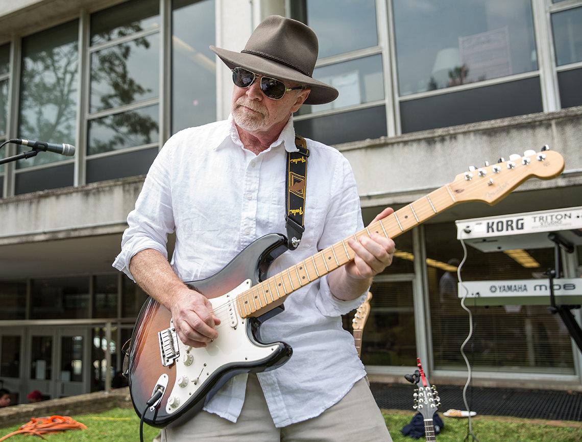 Dr. John O'Shea plays the electric bass.