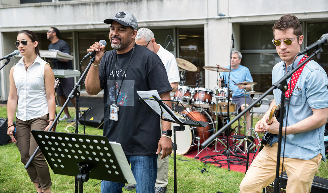 Members of the Directors band perform outside, raise money for charity.