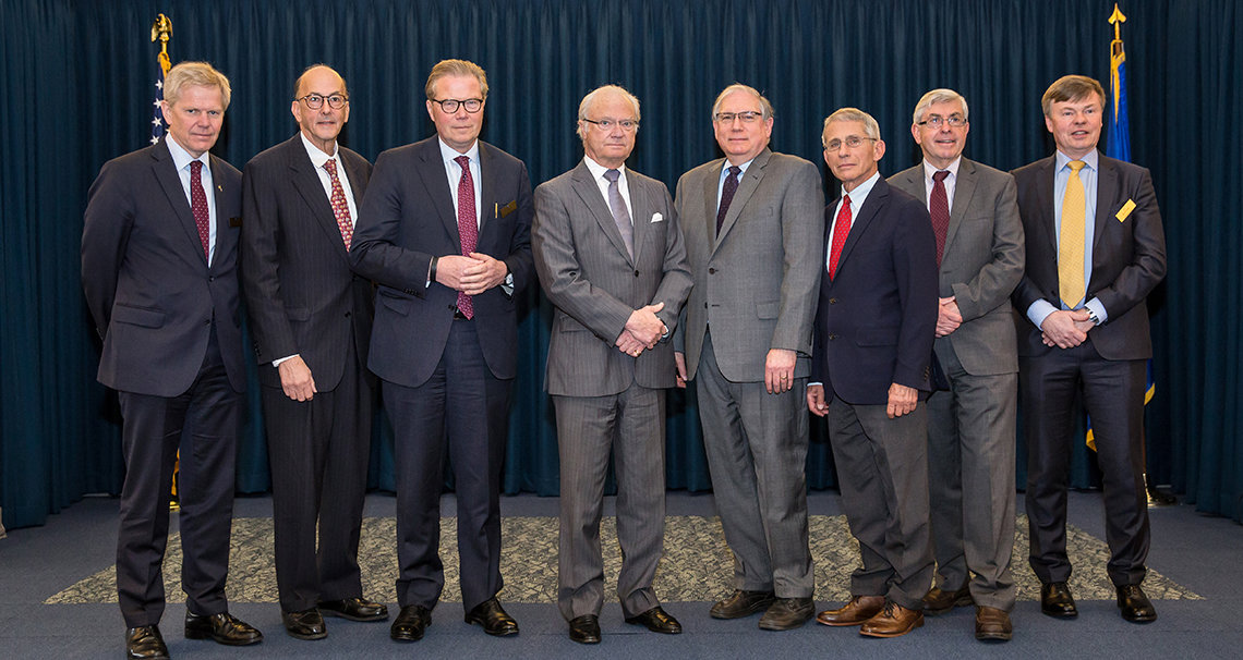 Sweden's King Carl poses with members of his delegation and NIH leadership