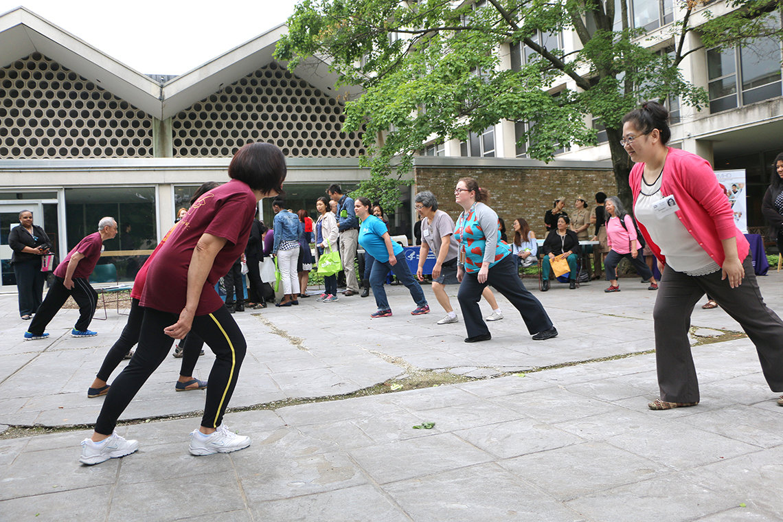 Attendees practice tai-chi.