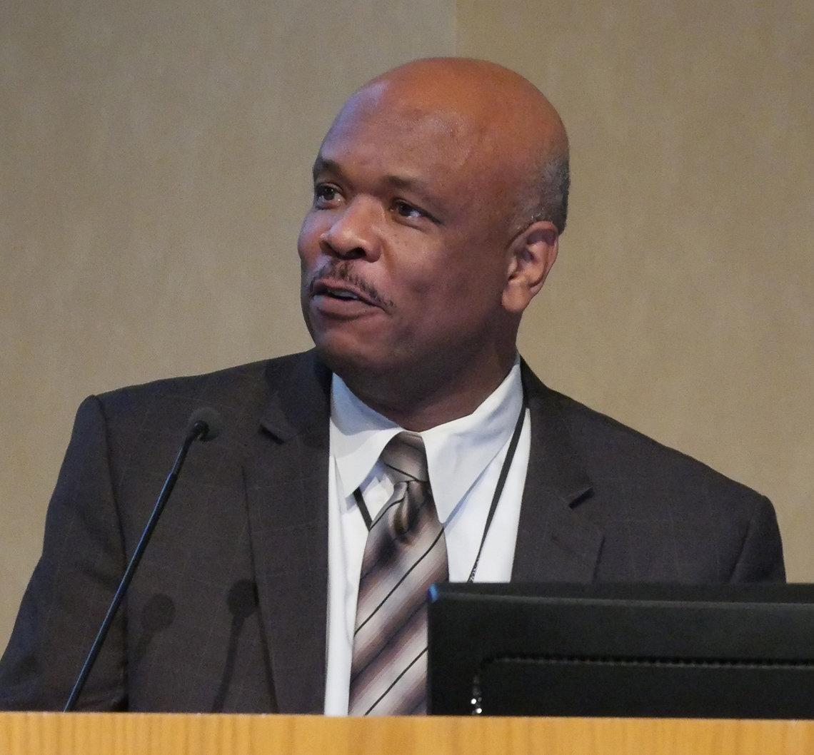 Dr. Johnson speaks at podium.