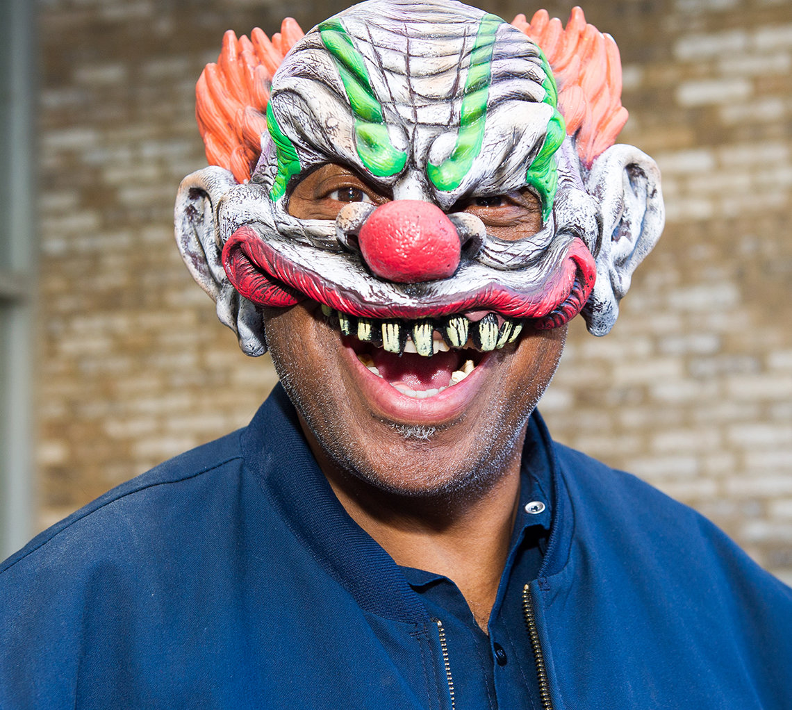A smiling NIH'er wearing a clown mask