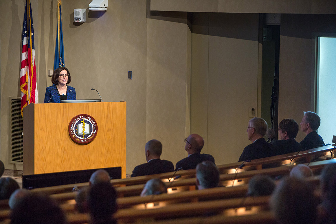 Dr. Córdova speaks in front of an audience