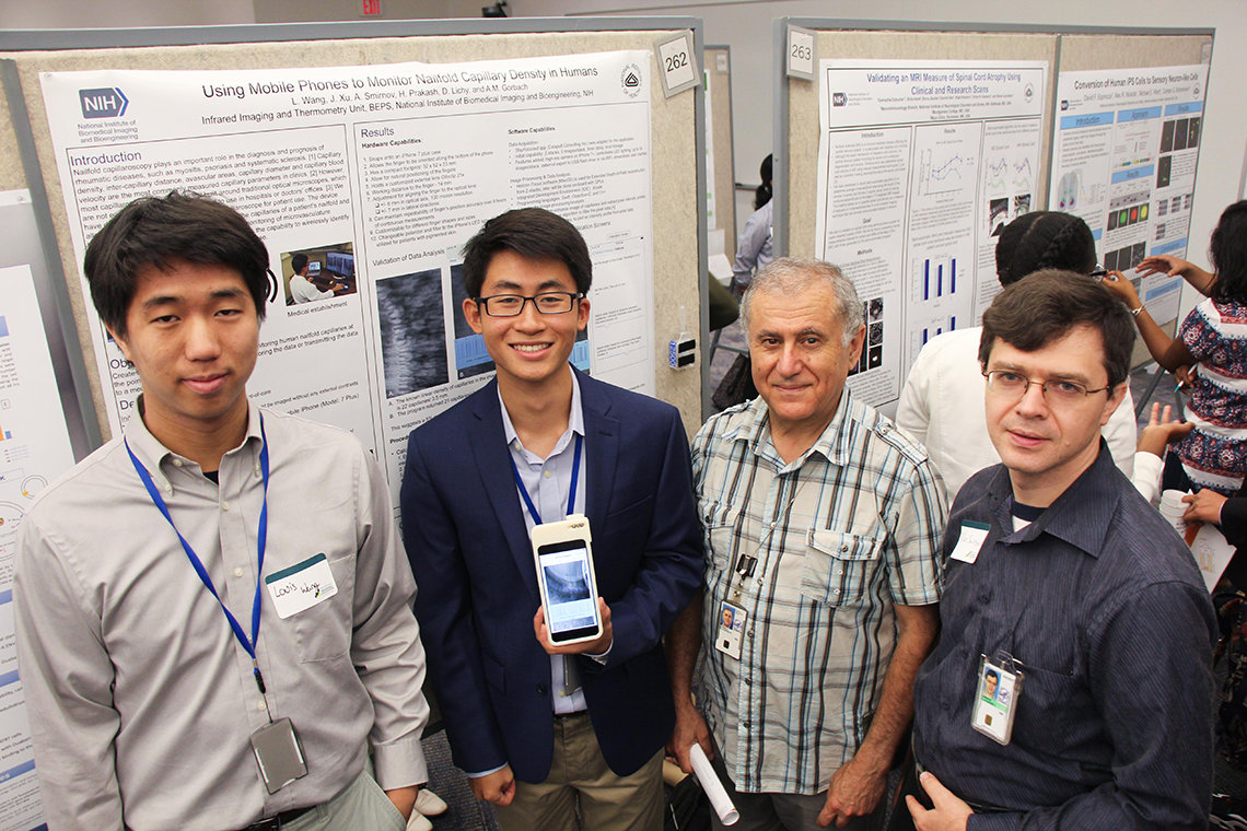 People at scientific poster