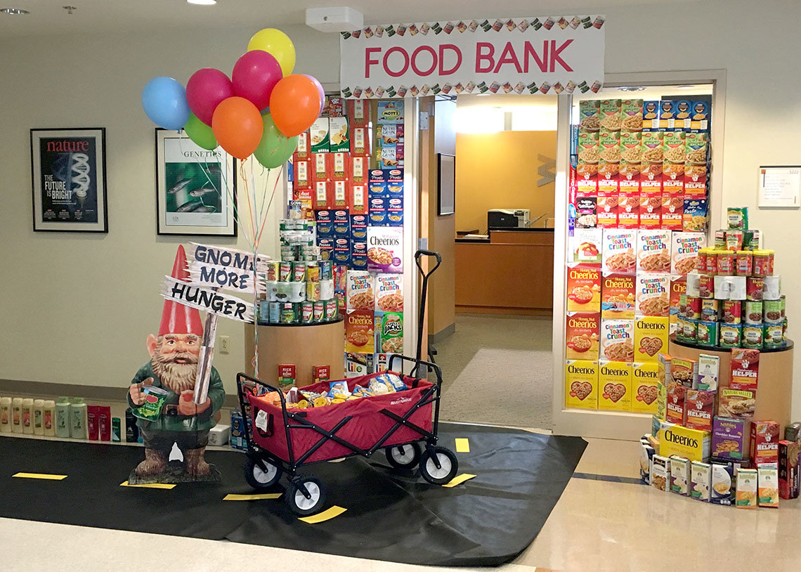 Open office doorway decorated with colorful cereal boxes and canned items