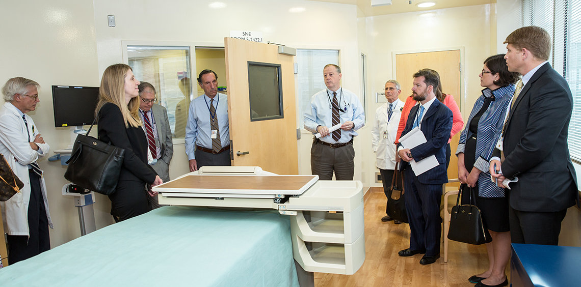 Davey briefs the group, standing in a patient room at the Clinical Center.