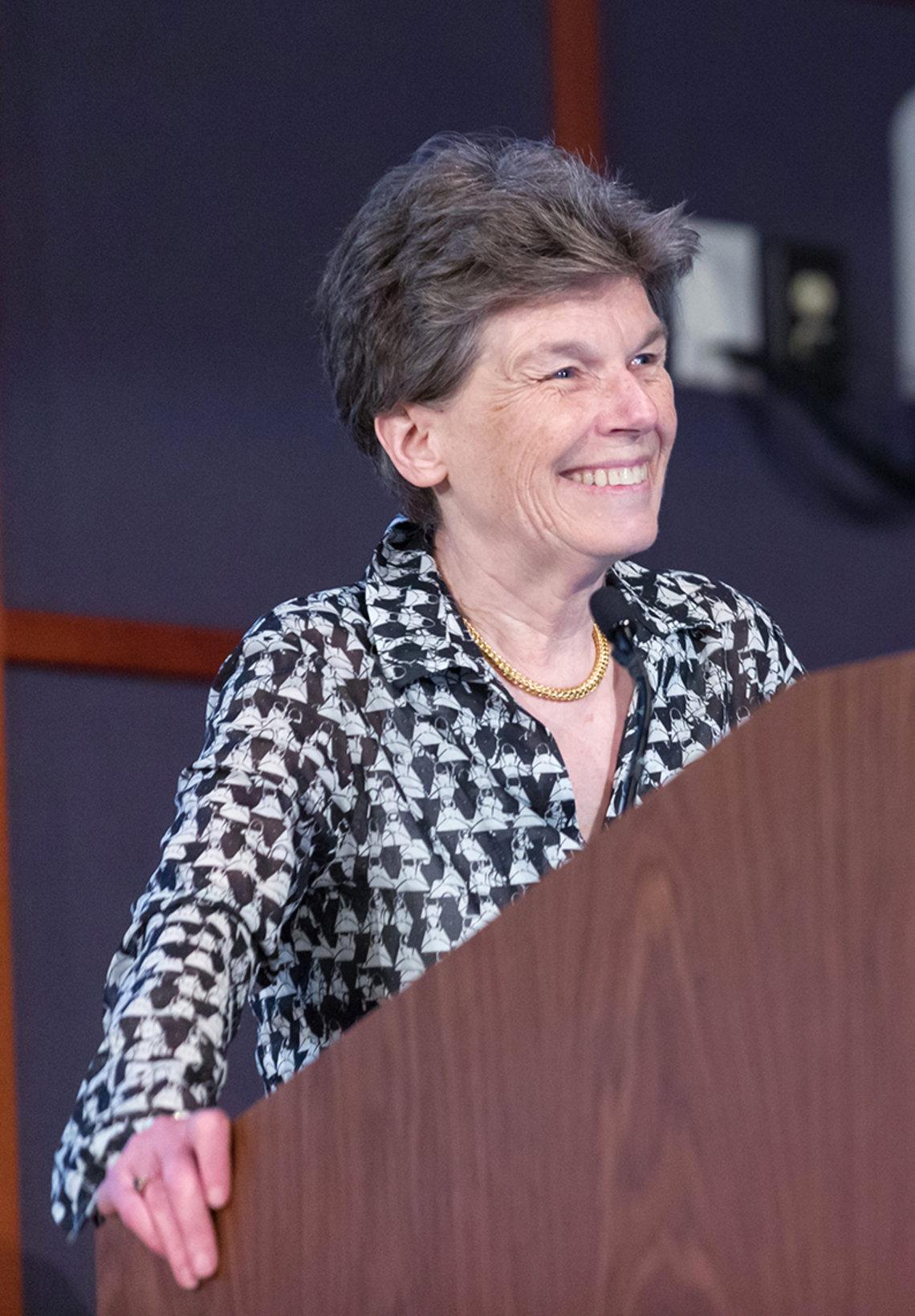 A smiling Humphreys stands at podium