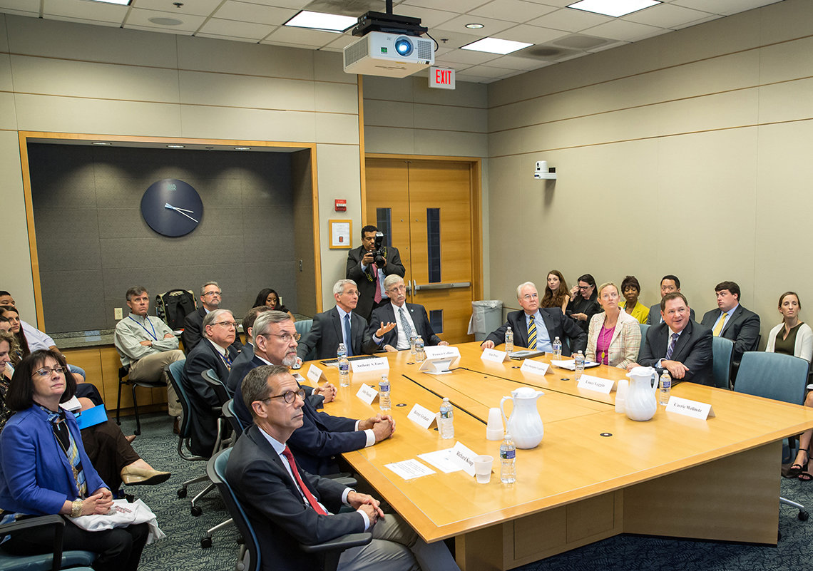 NIH leadership sits around a conference table