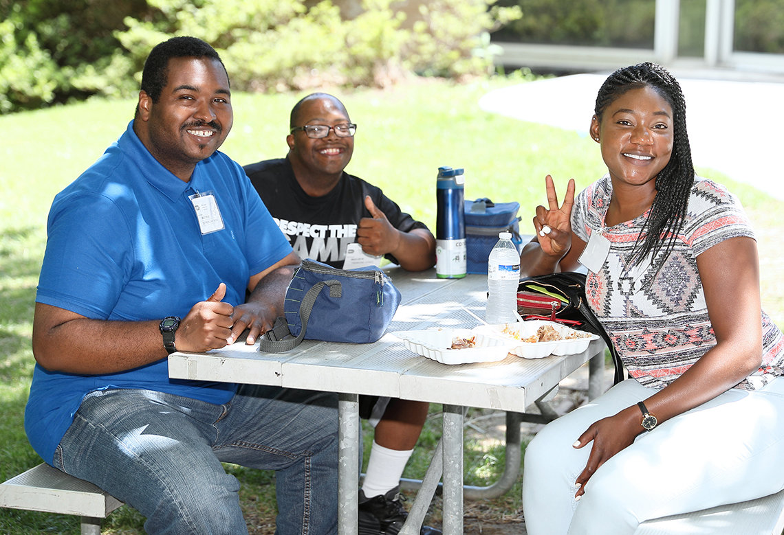 Attendees enjoy regional cuisine on the Bldg. 31 patio.
