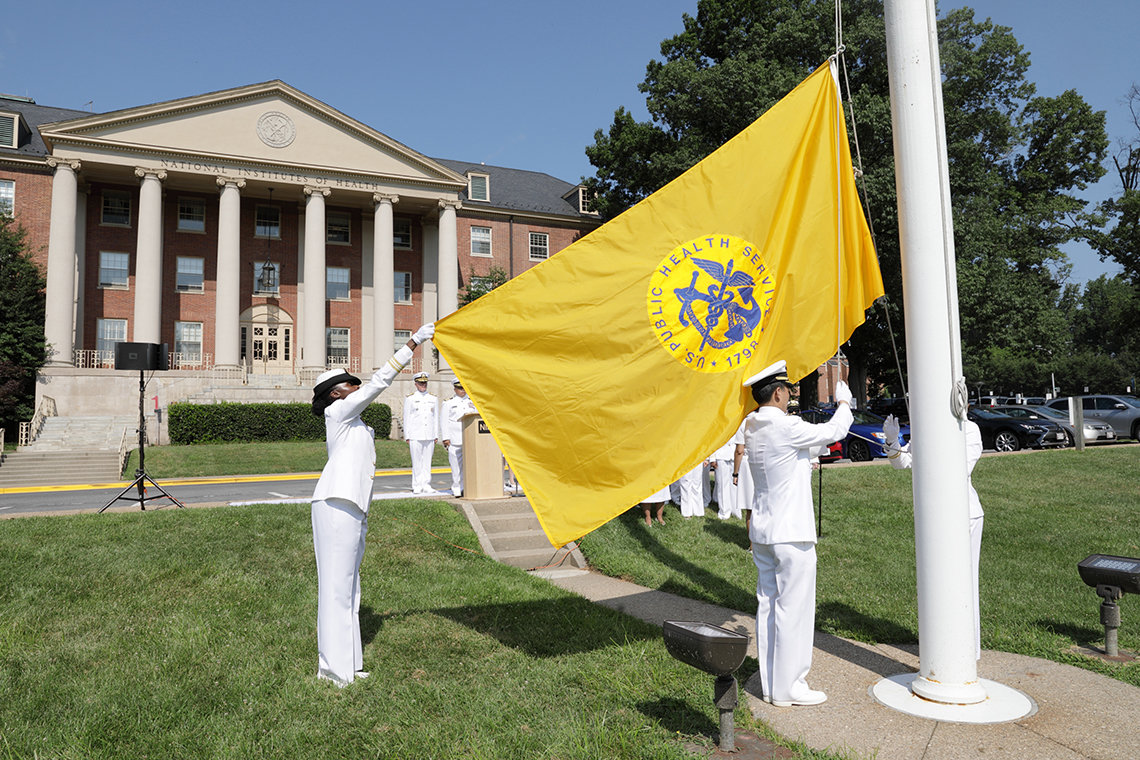 The Public Health Service flag is raised.