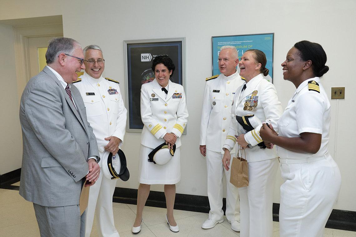 Tabak, Radm. Rick Childs, Orsega, Giroir, Lt. Elizabeth Cohen, and Capt. Tiffany Edmonds