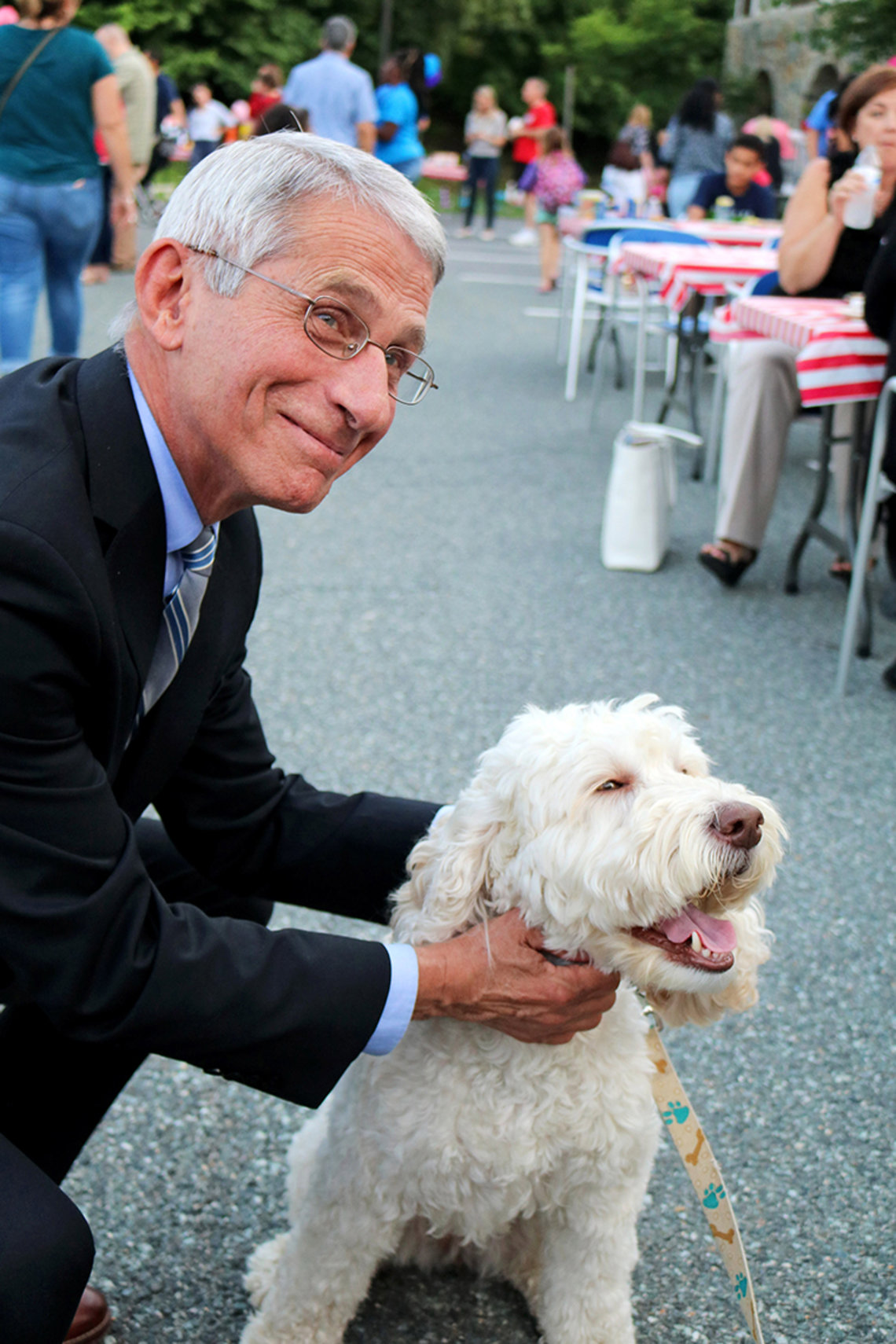 Dr. Anthony Fauci poses with Zilly, the Children's Inn therapy dog.